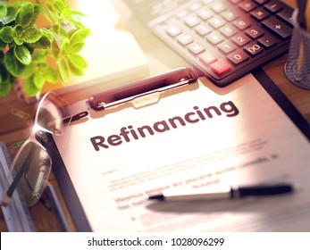 Refinancing- Text on Paper Sheet on Clipboard and Stationery on Office Desk. 3d Rendering. Toned and Blurred Image.