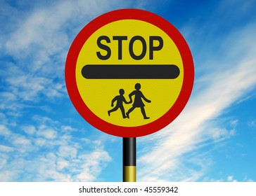 Reflective metallic school crossing patrol 'lollipop' sign, against a blue sky.