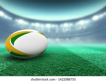 A reguar white rugby ball with yellow and green design elements resting on a stadium grass pitch at night under illuminated floodlights - 3D render