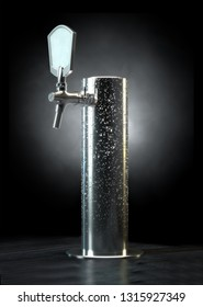 A regular chrome draught beer tap with cold condensation on an isolated dark background - 3D render