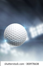 A regular golf ball flying through the air on an indoor stadium background during the night