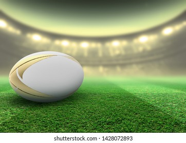 A regular white rugby ball with green design elements resting on a stadium grass pitch at night under illuminated floodlights - 3D render