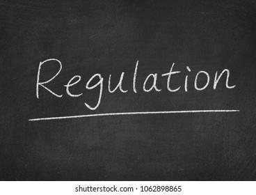 regulation concept word on a blackboard background