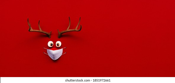 Reindeer toy with cold red nose and medical mask on red Christmas Corona background 3D Rendering, 3D Illustration
