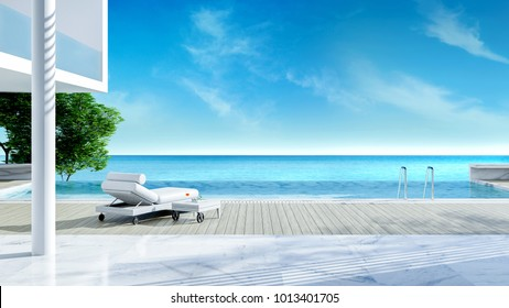 Relaxing summer,,beach lounge, sun loungers on Sunbathing deck and private swimming pool with near beach and panoramic sea view at luxury house /3d rendering