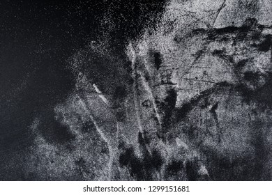 Remains of white powder on a black background