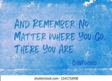 And remember, no matter where you go, there you are - ancient Chinese philosopher Confucius quote printed on grunge blue paper