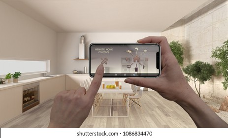 Remote home control system on a digital smart phone tablet. Device with app icons. Interior of minimalist white kitchen in the background, architecture design, 3d illustration