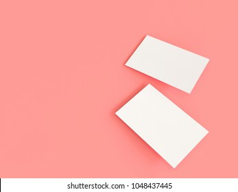 render 3d images of business cards dynamically scattered on a pink background.