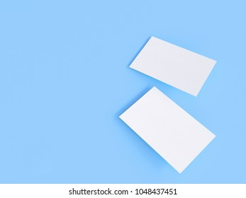 render 3d images of business cards dynamically scattered on a blue background.
