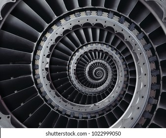 Repetitive metallic industrial turbine blades twisted to spiral with center misalignment. Production technology background. Abstract metal turbine wings round turbine staircase.