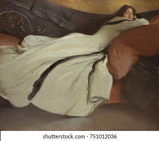 REPOSE, by John White Alexander, 1895, American painting, oil on canvas. Dramatic sensual images of a woman with a sultry facial expression and curves emphasized by her costume. The dramatic modern cl