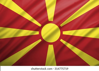 Republic of Macedonia flag blowing in the wind. Background texture.