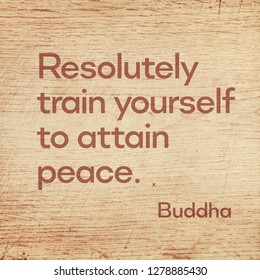 Resolutely train yourself to attain peace - famous quote of Gautama Buddha printed on grunge wooden board