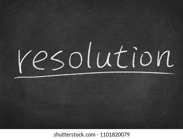 resolution concept word on a blackboard background