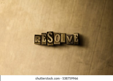 RESOLVE - close-up of grungy vintage typeset word on metal backdrop. Royalty free stock - 3D rendered stock image.  Can be used for online banner ads and direct mail.