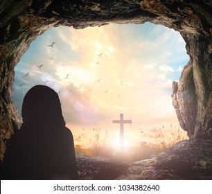 Resurrection concept: Jesus Christ is risen from tomb with cross on sunrise background