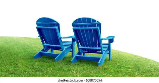 Retirement Planning symbol with two empty blue adirondack lawn chairs sitting on green grass as a financial concept of future successful investment strategy on a white background.
