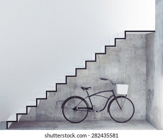 retro bicycle with basket in front of the interior concrete wall, background