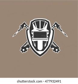 Retro vintage design logo with masks of the welder