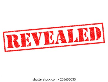 REVEALED red Rubber Stamp over a white background.