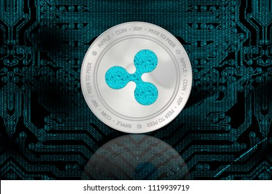 Ripple crypto currency (XRP) closeup. Silver coin on dark background. Cyber money.