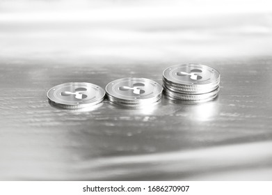 Ripple (XRP) digital crypto currency. Stack of silver coins. Cyber money. 3D Render.