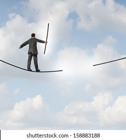 Risk management solutions business metaphor as a businessman walking on a tight rope with a missing piece of rope to complete the journey as a business leadership concept of adapting to change.
