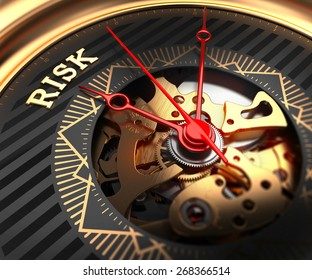 Risk on Black-Golden Watch Face with Watch Mechanism. Full Frame Closeup.