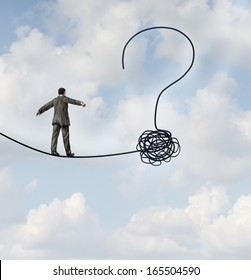 Risk uncertainty and planning a new journey as a businessman walking on a tight rope  shaped as a question mark as a metaphor for confusion at the road ahead as a business icon of finding solutions.