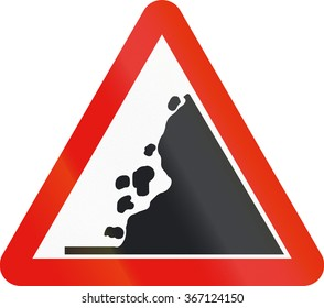 Road sign used in Spain - Falling rocks on the right.