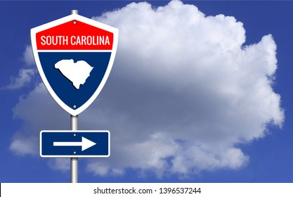 Road trip to South Carolina, Red, white and blue interstate highway road sign with word South Carolina and map of South Carolina with sky background