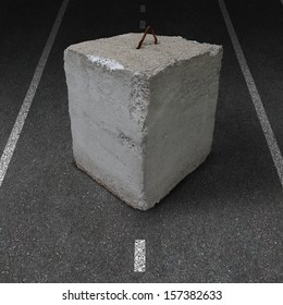 Roadblock obstacle and barrier business concept as a huge cement or concrete cube barricade blocking a road as a symbol of restricted opportunity or political gridlock or financial system shutdown.