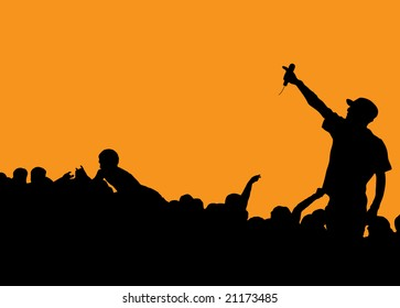 Rock concert with singer talking to the crowd on an orange background