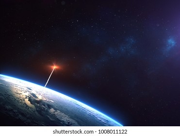 Rocket launch from the Earth planet orbit  through the clouds with a bright glow of the engine on the foreground and a bright blue nebula galaxy. Elements of this image furnished by NASA