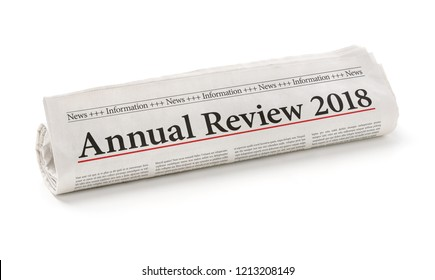 Rolled newspaper with the headline Annual review 2018