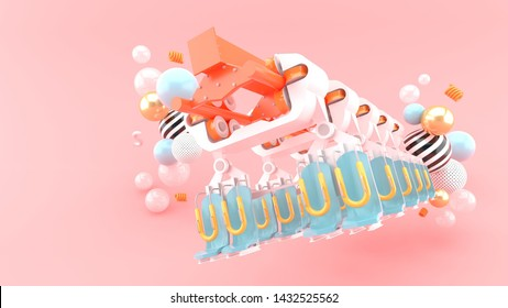 The roller coaster is surrounded by colorful balls on a pink background.-3d rendering.