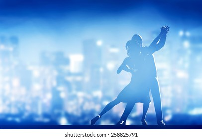 Romantic couple dance. Elegant classic pose. City nightlife background
