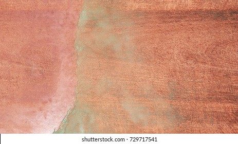 Rosegold concrete background. Shiny, glitter and glossy effect for an elegant and feminine wallpaper.