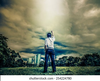 Rough illustration of a atheist man challenging the sky with light shine through the thick clouds in rough heavy grain grunge concept. He is demanding god and heaven to follow is rules.