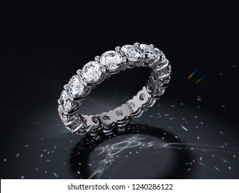 Round cut diamond eternity ring with beautiful caustics rays on black background. 3D illustration