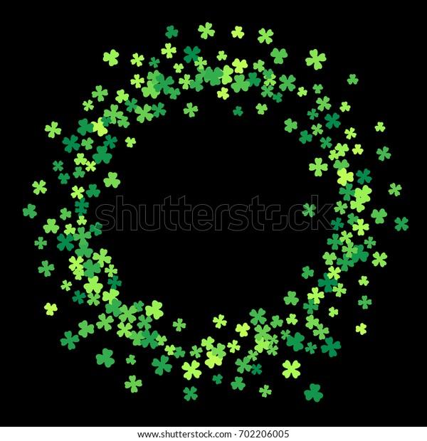 Round green frame, border or background of random scatter clover leaves. Elegant St. Patricks day design for festive banner, greeting card, postcard, flyer.