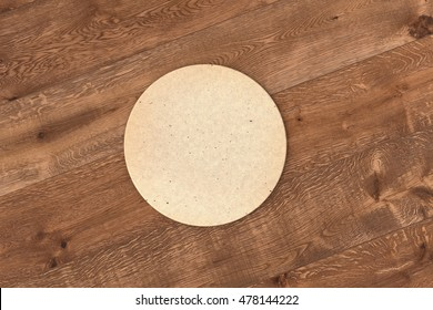 Round retro beer coaster. Isolated on wood background. 3d render