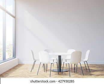 Round table and chairs in conference room interior with wooden floor, blank wall and window with city view. Mock up, 3D Rendering