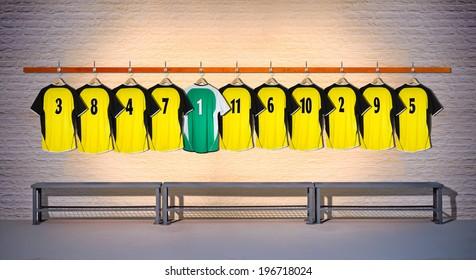 Row of Yellow Football Shirts with Green Shirt 3-5