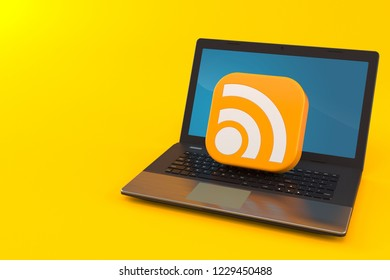 RSS icon with laptop isolated on orange background. 3d illustration