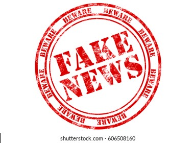 rubber stamp print in red with words fake news on white background
