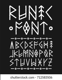 Runic hand drawn font. ink brush design.  Style of runic inscriptions. Ethno nordic viking font typeface painted Ink concept. Isolated on black background