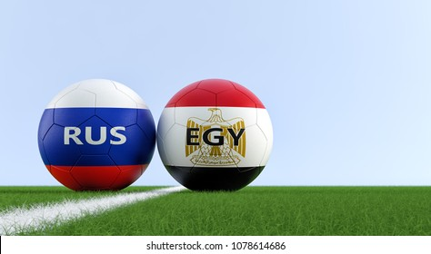 Russia vs. Egypt Soccer Match - Soccer balls in Egypts and Russias national colors on a soccer field. Copy space on the right side - 3D Rendering