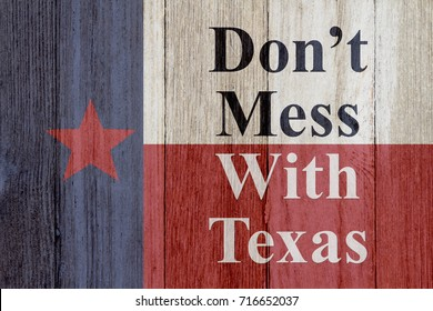 A rustic old Texas message, Texas flag on weathered wood background with text Don't mess with Texas 3D Illustration